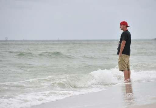 The white-sand beaches of Naples, Florida stood near-deserted as Hurricane Irma closed in