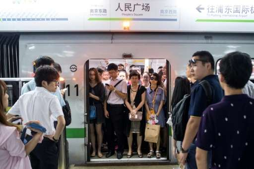This picture taken on July 19 shows commuters in the morning rush hour on line 2 of the Shanghai Metro in Shanghai