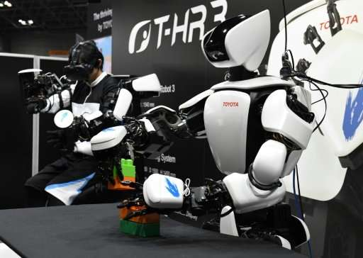 Toyota's T-HR3 can be controlled by a wearable system that allows users to operate the entire robot in real-time by simply movin