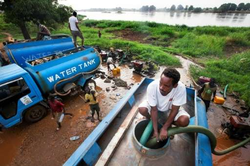 Truck drivers collect water directly from the Nile river to distribute to residents in Juba, South Sudan