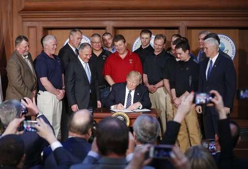 Trump tosses Obama's 'clean' energy plan, embraces coal