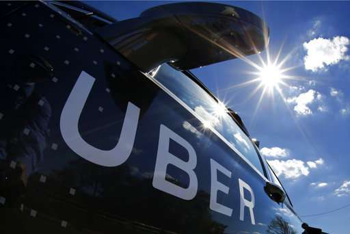 Uber trial on trade secrets delayed as federal probe emerges