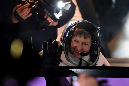 US astronaut Peggy Whitson waves to the crowd at the Russian-leased Baikonur Cosmodrome in November 2016