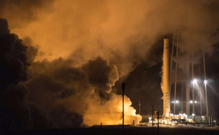 Used SpaceX booster set for historic first reflight is test fired in Texas