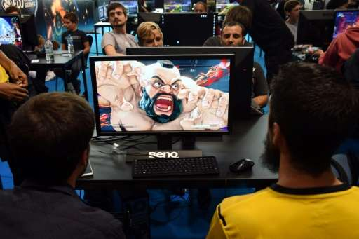 Video game players compete against each other, at the Palais des Congres in Bordeaux, France, during the eSports World Conventio