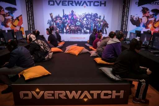 """Visitors play the video game """"Overwatch"""" at the 2016 Paris Games Week. Game developer Activision is creating an eSport"""