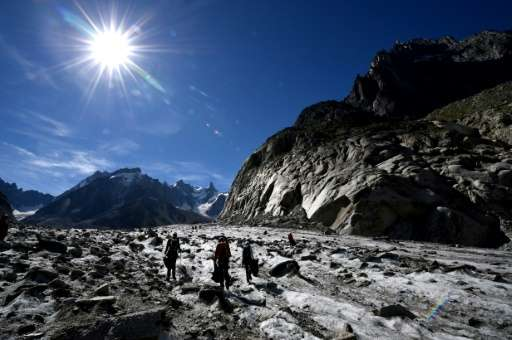 Volunteers collect wastes on the Mer de Glace glacier in Chamonix-Mont Blanc, French Alps, on September 2, 2016 during the annua