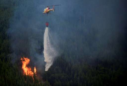 Water-bombing planes and helicopters continued their runs over the blaze, which has been burning since Saturday