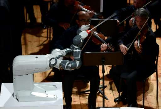 YuMi, designed by Switzerland's ABB, conducts the Lucca Philharmonic Orchestra on Tuesday at the Teatro Verdi in Pisa, Italy