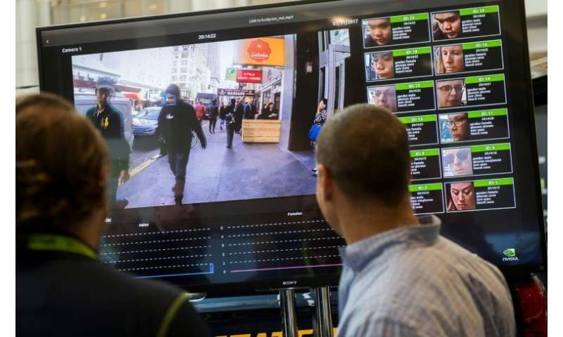 A display shows a facial recognition system for law enforcement during the NVIDIA GPU Technology Conference in 2017 in Washingto