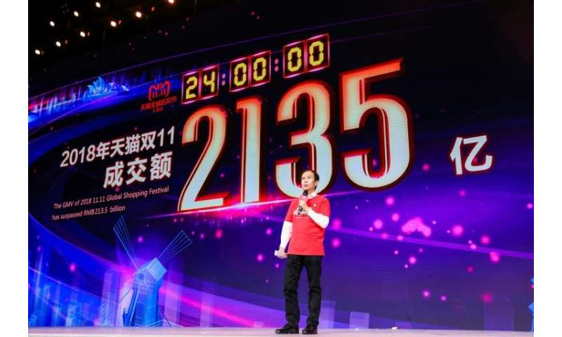 Alibaba CEO Daniel Zhang speaks in front of a screen showing total sales at over 213.5 billion yuan (30.7 billion USD) shortly a