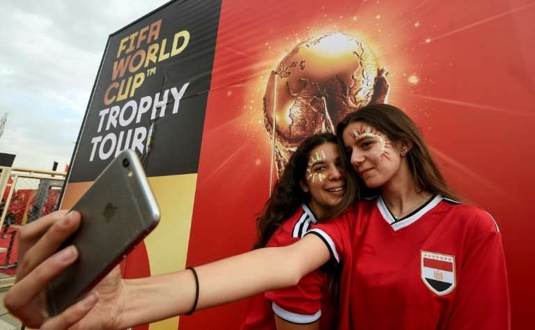 "Football fans pose for a ""selfie"" photograph taken with an iPhone in this file picture taken in Cairo on March 15, 201"