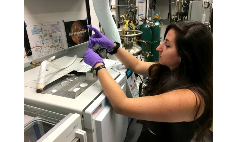 French post-doctorate researcher Maeva Millan at work at NASA's Goddard Space Center in Greenbelt, Maryland