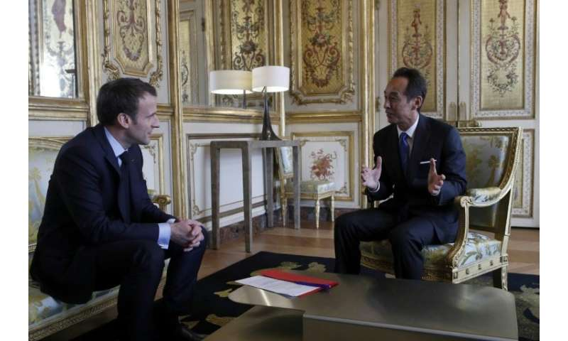 French President Emmanuel Macron meets with Samsung Electronics president and chief strategy officer,  Young Sohn, at the Elysee