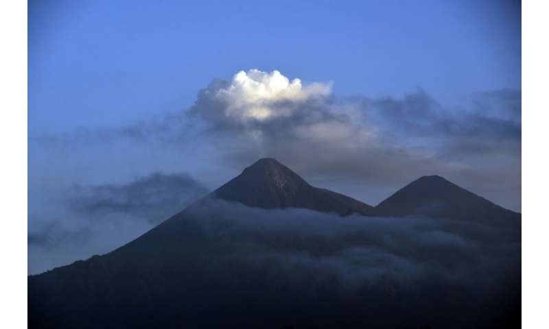 Guatemala's Fuego Volcano releases ash and smoke in this picture taken more than a week after a violent June 2018 eruption