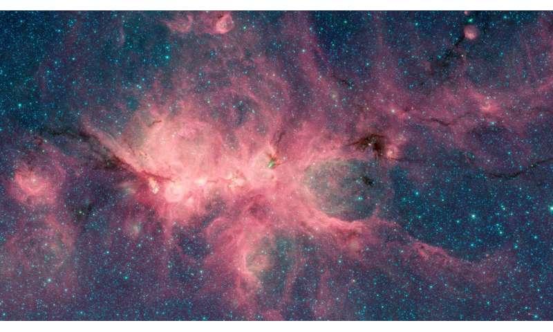 Image: Newborn stars blow bubbles in the Cat's Paw Nebula