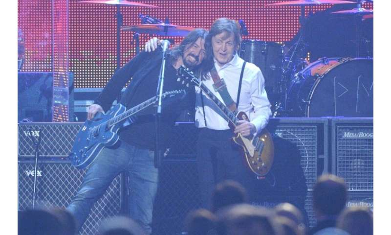 Music legend Paul McCartney (R with Dave Grohl) as well as major music labels and film studios have lobbied politicians urging t