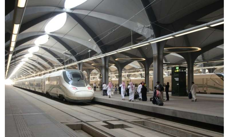 Passengers walk on the platform at Mecca train station on October 11, 2018 as Saudi Arabia's new high-speed railway opens
