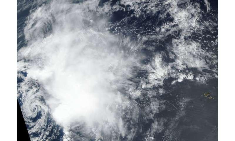 Satellite finds wind shear battering Tropical Storm Nadine