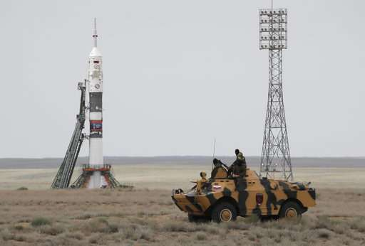 Soyuz capsule with 3 astronauts docks with space station