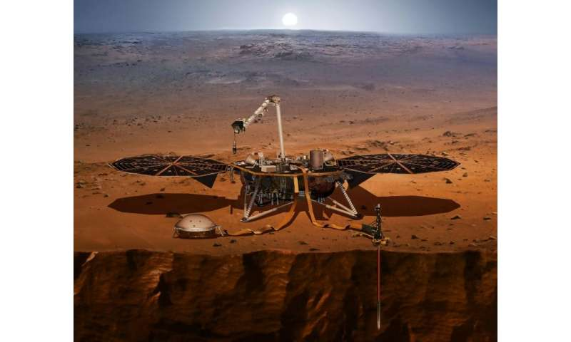 The InSight lander, seen here in a NASA handout illustration, is designed to monitor quakes on the surface of Mars