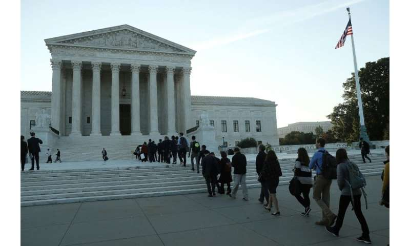 The US Supreme Court opens its new term with just eight of the nine justices, as US President Donald Trump's nominee Brett Kavan