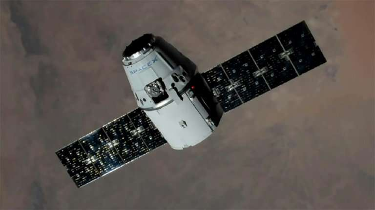 This NASA handout image shows an unmanned SpaceX Dragon cargo craft approaching the International Space Station in August 2017