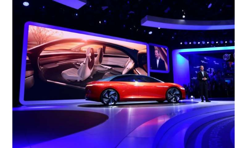 "Volkswagen CEO Herbert Diess showed off the ""I.D. Vizzion""  concept car, which is also conceived as being electric and"