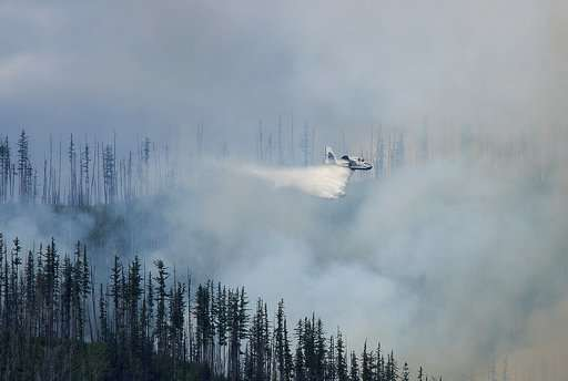 Wildfire forces evacuations in Glacier, Yosemite to re-open