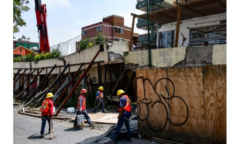 Workers preprare to demolish Enrique Rebsamen elementary school in Mexico city, on August 20, 2018. The school collapsed during
