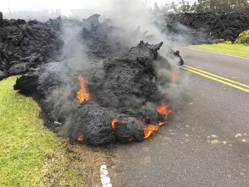 Lava flowing from Hawaii's Kilauea volcano destroys 9 homes