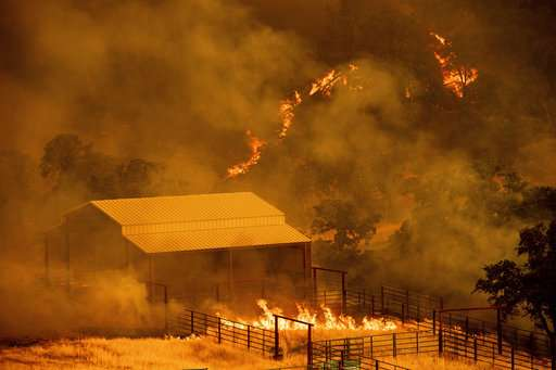 Wind spreads California fire as other states battle blazes