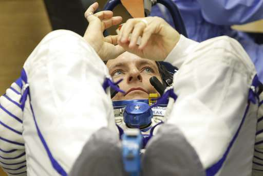 3 astronauts safely aboard International Space Station (Update)