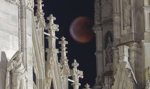 World gazes at total lunar eclipse, longest of this century