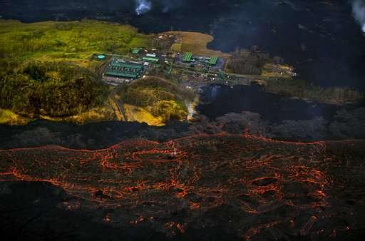 Hawaii volcano unleashes more small blasts, snaking lava