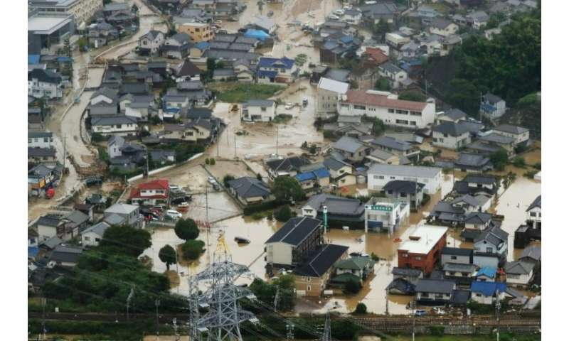 An aerial view of flooded houses in Japan's Hiroshima prefecture