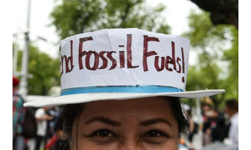 An environmental activist takes part in a demonstration in front of the United Nations building in Bangkok on September 8, 2018