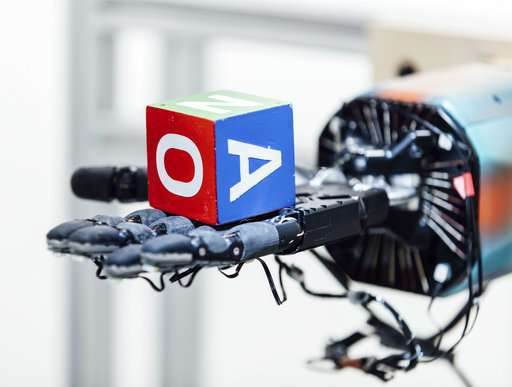 A robotic hand can juggle a cube -- with lots of training