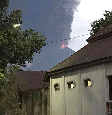 Volcano erupts on same Indonesian island as earlier quake