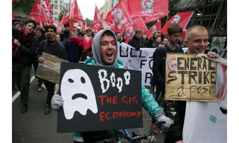Demonstrators, including Uber drivers, marched in London as the ride-hailing firm sought tooverturn employment tribunal rulings