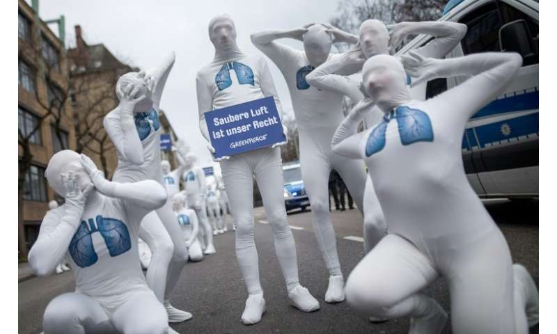 Greenpeace activists wearing white morphsuits with lungs painted on them demonstrated for clean air in Stuttgart in February. Th