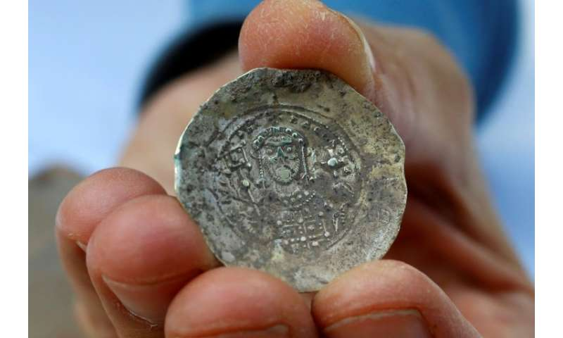A picture taken on December 3, 2018, shows an ancient gold coin uncovered at an excavation site in the Israeli Mediterranean tow