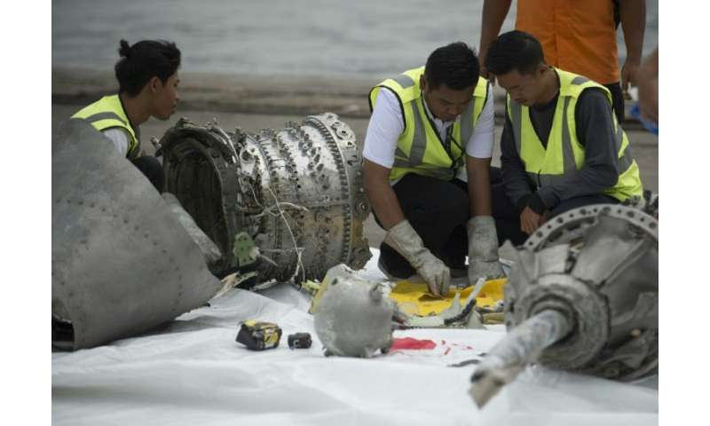 Investigators examine engine parts from the ill-fated Lion Air flight JT 610, after they were recovered from the bottom of the J
