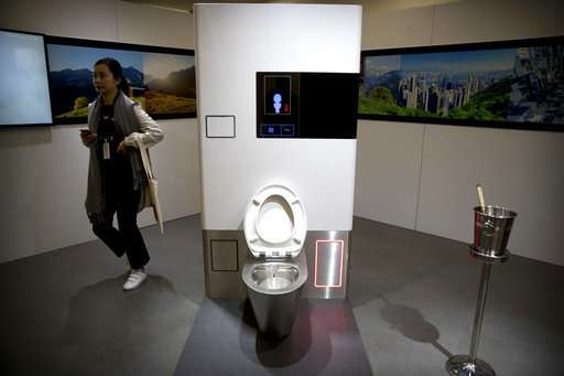 With poo on a pedestal, Bill Gates talks toilet technology