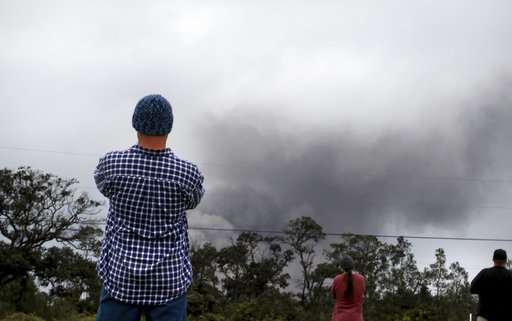 Light coats of gritty ash fall near erupting Hawaii volcano