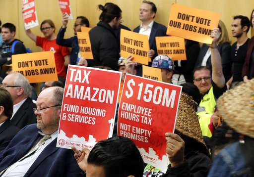 Seattle OKs taxing companies like Amazon to aid the homeless