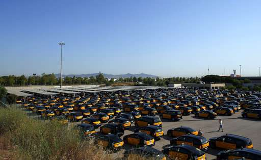 Barcelona taxis strike for 2nd day, tourists face delays