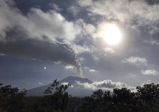 Bali airport closed as Agung volcano gushes column of ash