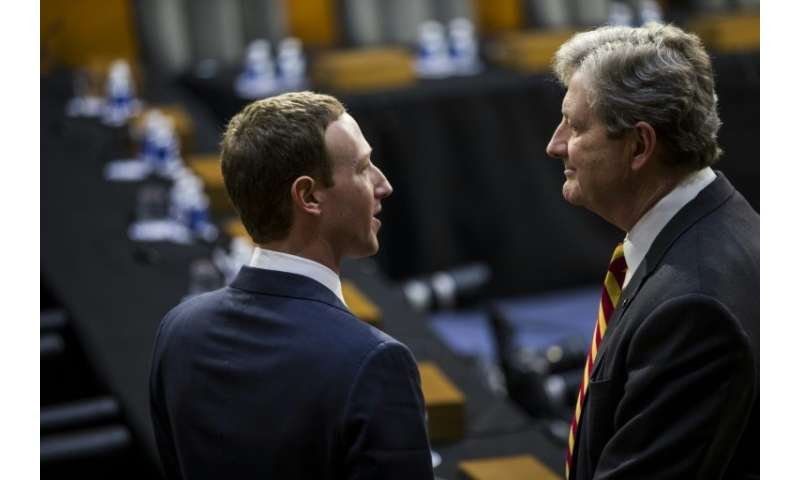 Facebook CEO Mark Zuckerberg, left, speaks to US Senator John Kennedy ahead of an April 10 hearing on privacy concerns about the