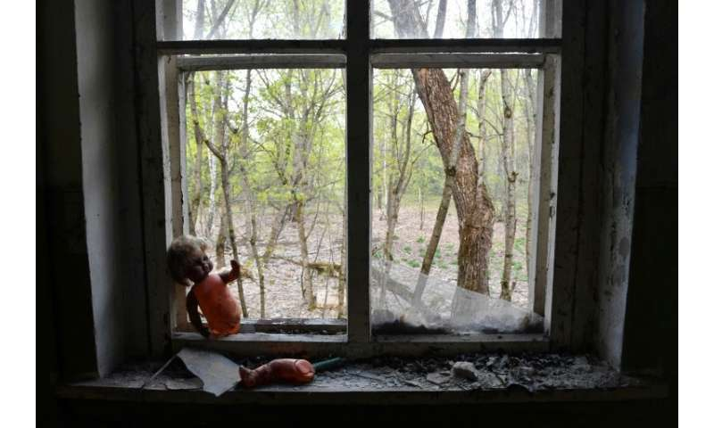Abandoned kindergarten toys lay around in the ghost village of Kopachi near the Chernobyl nuclear power plant